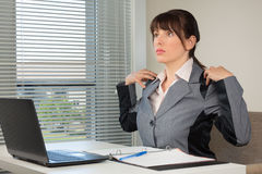 The office routine. The image of business woman doing exercise at the office Stock Photo