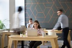 Office rush concept, employees working together in coworking usi royalty free stock image