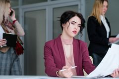 Office rush sad pensive business woman thinking. Office rush and buzz. sad pensive business women sitting at the desk thinking. work problems concept royalty free stock images
