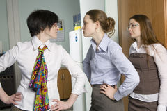 Office`s conflict. Two colleagues quarrel. Woman look at conflict Royalty Free Stock Photography