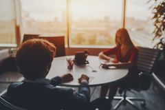 Meeting of two business persons in glass room stock images
