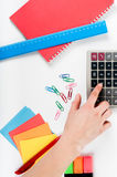 Office, school, business, education and technology concept - clo. Se up of notebook, paper stickers, pencil, clip, calculator, different stuff on white Stock Image