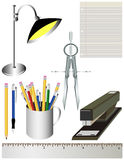 Office or School Supplies. An assortment of various office or school supplies - a desk lamp, piece of lined paper, compass, pencils and pens, stapler and ruler Stock Photography