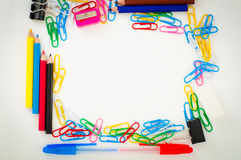 Office or school supplies background with empty center for your text or logo Royalty Free Stock Image
