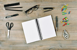 Office and school supplies. Open book and writing tools retro st Stock Image