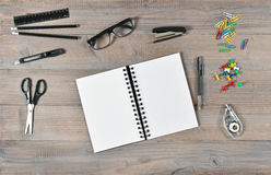 Office and school supplies. Open book and writting tools Royalty Free Stock Photo