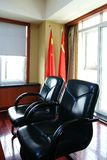 Office Seating Area with Chinese Flags Royalty Free Stock Image
