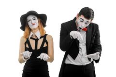 Office secretary and annoying chief. Female and male mimes are performing a comedy sketch, typing on imaginary keyboard, pointing at the mistakes. Office stock photography