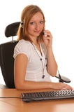 In the office-secretary girl on phone Royalty Free Stock Image