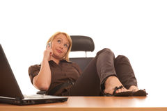 In the office-secretary girl speaking on phone Royalty Free Stock Images