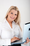 Office secretary with laptop Royalty Free Stock Images
