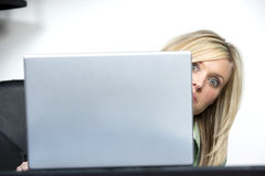 Office Secrets. A business woman over hearing some office gossip Royalty Free Stock Photos
