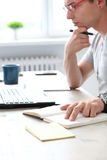 Office. Serious man at work Royalty Free Stock Images