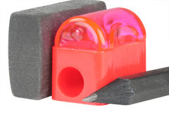 Office set pencils and pencil sharpener. Office set of the crayons and red pencil sharpener on white background Royalty Free Stock Photos