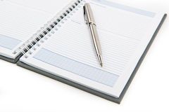Office set. Spiral notebook with metalic pen Stock Image