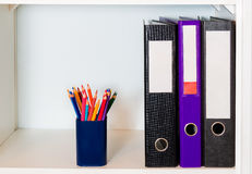Office shelf with folders and pencil holder Royalty Free Stock Photo