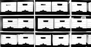Office shelves full of files and boxes Royalty Free Stock Photo