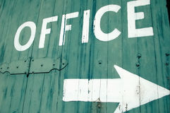 Office Sign. Office painted on an old building stock photos