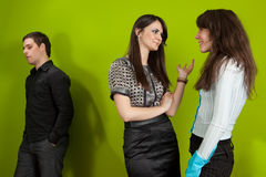 Office situation. Group of three young people in the office Royalty Free Stock Photography