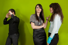 Office situation. Group of three young people in the office Stock Photography