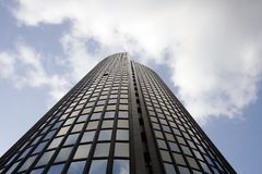 Office in the sky. Glass office building with sky and clouds in the background Royalty Free Stock Images