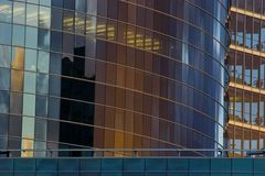 Office skyscraper building facade. Corporate office building facade and reflection of other skyscraper in late evening Stock Images