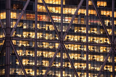 Office skyscraper windows at night. Office windows in the City of London, evening light Stock Photo