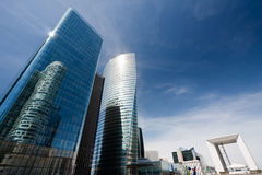 Office skyscrapers with the Grand. Tall reflective buildings together with the La Grande Arche in Paris, France royalty free stock photo