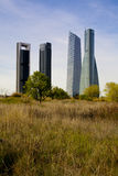 Office skyscrapers in Madrid business district in contrast surr Stock Image