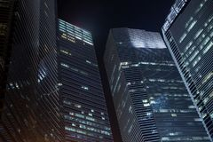 Office skyscrapers at night Stock Photography