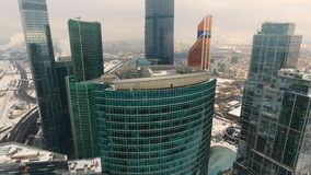 Office skyscrapers in winter day. Aerial. stock footage