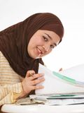 Office smile. Young veiled office worker browsing through her files Stock Photo