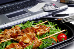 Office snack. Turkey breast on rucola in a box Royalty Free Stock Photos