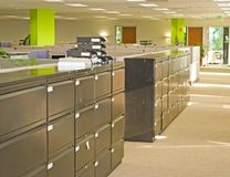 Office Spaces. Corporate office settings showing desks, cubicles, files, and conference space