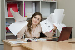 Office Specialist with a bunch of papers Royalty Free Stock Photography