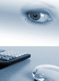 Office spy. Illustration of desktop with calculator and computer mouse. Woman's eye overlaid giving surreal effect Royalty Free Stock Photos