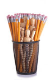 Office Staff. Wooden mannequins in a black metal pencil cup with many yellow pencils. Conceptual image for office staff; workforce; secretarial; employment, etc royalty free stock images