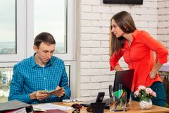 Office staff argue about payroll. Office staff argue about  payroll royalty free stock images