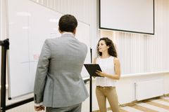Office staff showing presentation on a blurred background. Business presentation concept. Copy space. stock photos