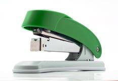 Office stapler. Plastic stapler green white background Stock Image