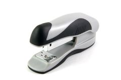 Office stapler. Black and gray office stapler; isolated on white background royalty free stock image