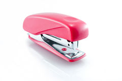 Office stapler. A small red office stapler on white Royalty Free Stock Photography