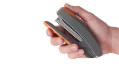 Office stapler in hand on white Stock Photos