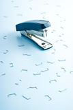 Office stapler and many clips Stock Photography