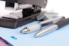 Office stapler and pen Stock Image