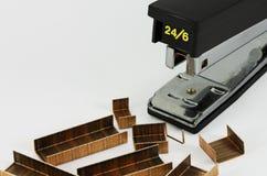 Office stapler and staple strips. Black office stapler and some staple strips Stock Image