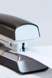 Office stapler stapling white paper Royalty Free Stock Photography