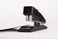 Office stapler with white card Royalty Free Stock Images