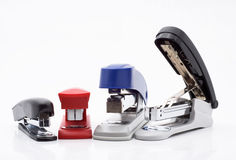 Office Staplers. Range of different office Staplers, white background Royalty Free Stock Image
