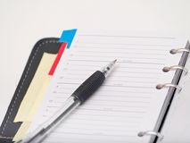 Office stationary - Pen and diary on white Stock Photo